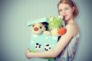 woman-holding-box-of-toys